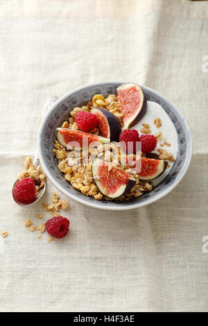 Granola with figs and raspberry, healthy food - Stock Photo