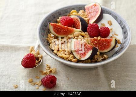 Muesli with figs and raspberry, food closeup - Stock Photo
