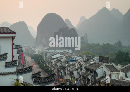 View of evening city and mountains in Yangshuo, China - Stock Photo