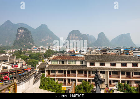 View of the roofs and mountains in Yangshuo, China - Stock Photo