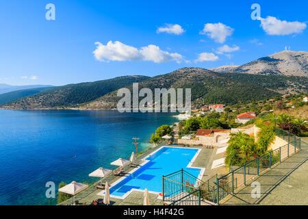 Swimming pool with sea and mountain view on coast of Kefalonia island in Agia Efimia village, Greece - Stock Photo