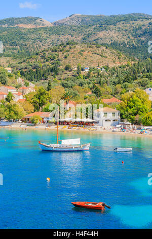 Colorful houses of Assos village and boats on sea, Kefalonia island, Greece - Stock Photo