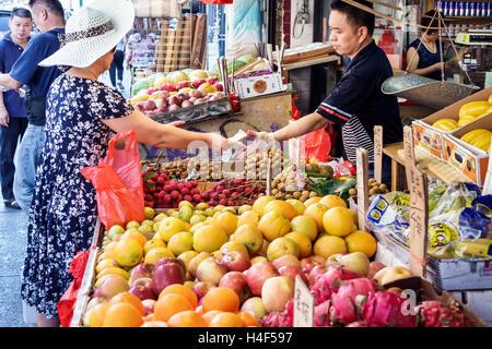 Lower Manhattan New York City NYC NY Chinatown business shopping market fresh fruit stand exotic fruit dragon fruit - Stock Photo