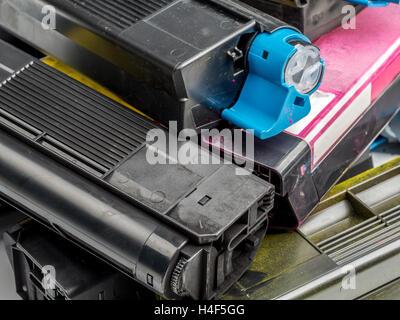 pile of used color laser printer toner cartridges stock photo