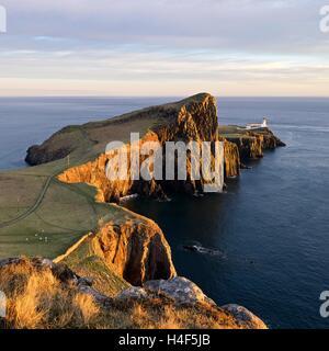 Golden light hits the famous Neist Point on the Isle of Skye - Stock Photo