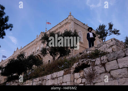 An Ultra orthodox Jew gazing from the Greek orthodox seminary in Mount Zion Old city East Jerusalem Israel - Stock Photo