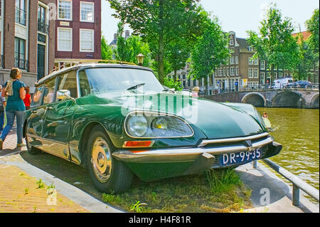 Retro car Citroen DS parked on the embankment of the canal - Stock Photo
