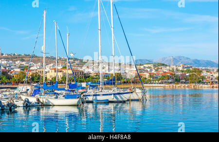 The the view from the new port on the coastline of Rethymno with the modern districts on the hilly area, Crete, - Stock Photo