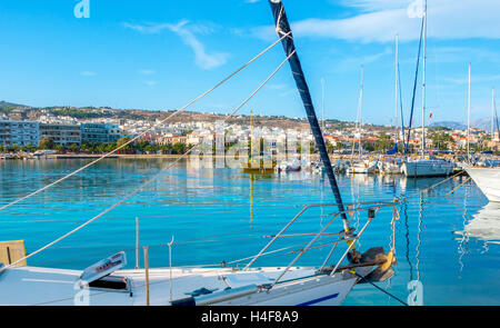 The view through the sails and ropes of the yacht on the coastline of the modern tourist districts of Rethymno, - Stock Photo