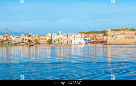 The new port overlooks the old Rethymno promenade with its landmarks -Fortezza citadel, lighthouse at the old harbor, - Stock Photo