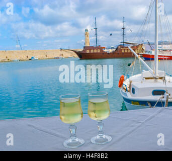 The best place for romantic supper is the small cozy cafe in The Old Venetian Port with a view on medieval ship, - Stock Photo