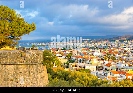 The view on Rethymno city and its port from the  Fortezza (Venetian citadel), located on the hill, Crete, Greece. - Stock Photo