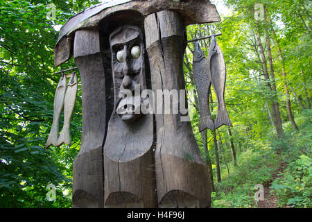 Sculptures -- more than 80 of them -- intricately hand-carved from oak to represent characters from Lithuanian mythology. - Stock Photo