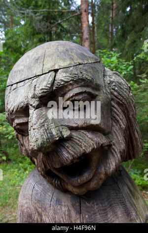 Sculptures -- 80 of them -- intricately hand-carved from oak to represent characters from Lithuanian mythology are - Stock Photo
