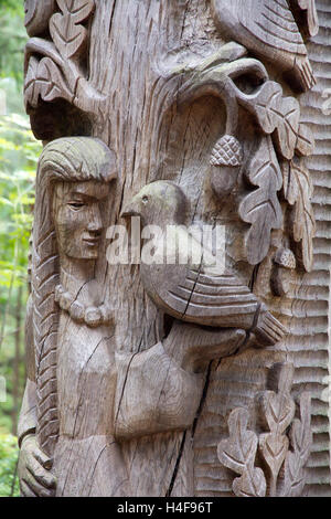 Sculptures -- more than 80 of them -- are intricately hand-carved from oak to represent characters from Lithuanian - Stock Photo