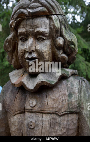 Sculptures -- over 80 of them -- intricately hand-carved from oak to represent characters from Lithuanian mythology. - Stock Photo