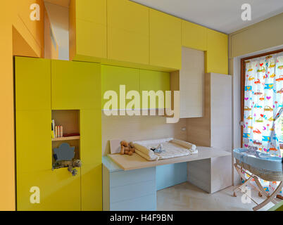 interior view of a modern kids room with colored furniture - Stock Photo