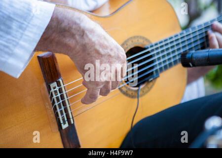 Spanish flamenco guitarist playing. Selective focus on hand - Stock Photo