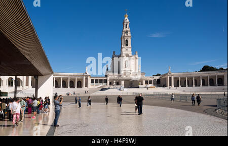 The Basilica of Our Lady of the Rosary of Fatima and the Chapel of the Apparitions on the left in Fatima, Portugal - Stock Photo