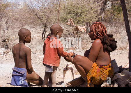 mother and her son of himba tribe in north namibia - Stock Photo