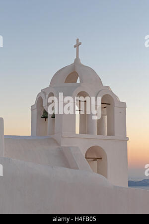 tower bell of Agios Minas church in Fira at sunset - Stock Photo