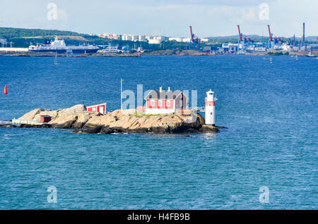 House and beacon in the entrance of Göteborg / Gothenburg from the Göta älv/river, Sweden - Stock Photo