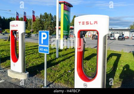 Tesla supercharger parking lot in Sweden - Stock Photo