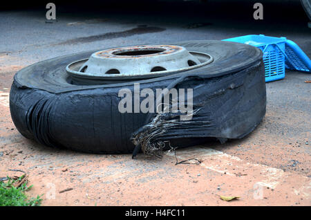Wheel tire of bus broken and explosion on the road at countryside of Thailand - Stock Photo