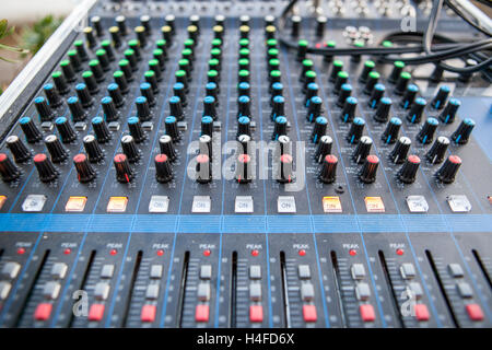 Sound board closeup for outside live performance. Selective focus - Stock Photo