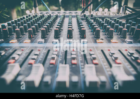 Sound board closeup for outside live performance. Retro filtered - Stock Photo