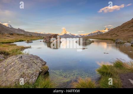 Sunrise on the Matterhorn at Stellisee Lake, Zermatt, Switzerland. - Stock Photo
