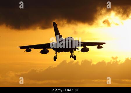 RAF Panavia Tornado GR4 landing at sunset - Stock Photo