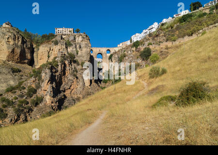 Ronda, Malaga Province, Andalusia, southern Spain.  The town on both sides of the El Tajo gorge, seen from below. - Stock Photo