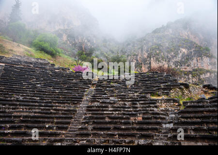 Delphi, Greece. In Greek mythology the site of the Delphic oracle. The ancient theatre. - Stock Photo