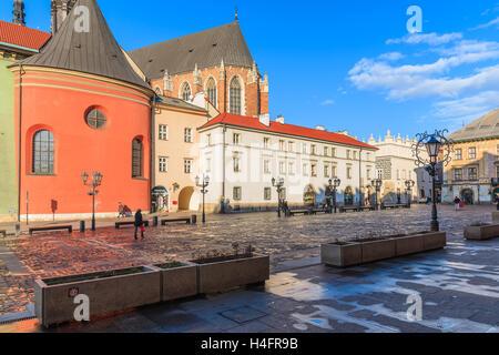 KRAKOW, POLAND - DEC 12, 2014: Mariacki church and colorful houses on market square of Krakow city (Maly Rynek). - Stock Photo