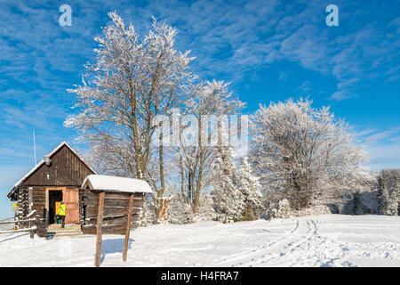 Mountain hut in Beskid Sadecki Mountains on sunny winter day, Poland - Stock Photo