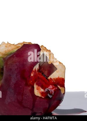 Bloody apple Halloween horror razor blade in apple - Stock Photo