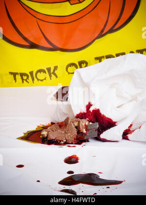 Bloody apple Halloween horror razor blade in candy - Stock Photo