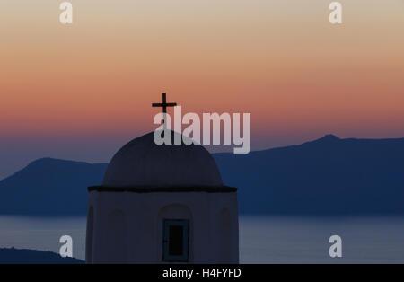 dome of church on Santorini at sunset - Stock Photo