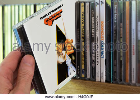 Sound track from the film A Clockwork Orange CD being chosen from a shelf of other CD's - Stock Photo