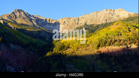 mountains with snow and yellow aspen Colorado landscape - Stock Photo