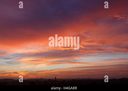 Stunning red shepherds warning sky over Glasgow as the sun rises - Stock Photo
