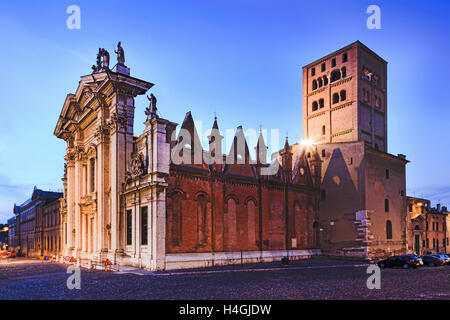 Side-view of Duomo di Mantua at Sordello square in the middle of the city at sunset with nobody on empty cobblestone - Stock Photo