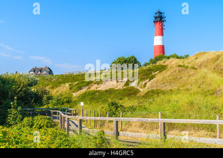 Lighthouse on sand dune against blue sky in Hornum village on southern coast of Sylt island, Germany