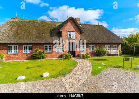 sylt island germany sep 11 2016 traditional house with thatched stock photo royalty free. Black Bedroom Furniture Sets. Home Design Ideas