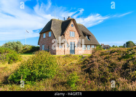 Traditional Red Brick House With Thatched Roof On Meadow Near Wenningsted  Village On Sylt Island