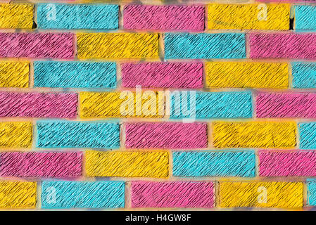 Brick wall painted in bright yellow, blue and pink colors - Stock Photo