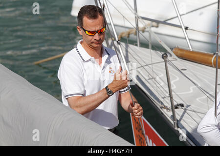 Spain Royal King Felipe arriving at the nautical club to sail sailboat during the king's cup. On his summer holidays - Stock Photo
