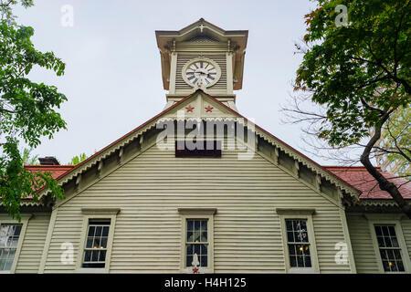 The historical Sapporo Clock Tower (Tokeidai) at Sapporo, Hokkaido, Japan - Stock Photo