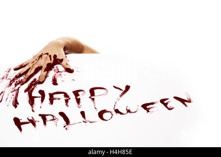 Bloody hand and Happy halloween written with red human blood on white background. - Stock Photo